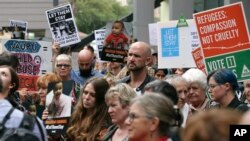 FILE - Protestors against asylum seekers being deported, gather for a rally in Sydney, Australia, Thursday, Feb. 4, 2016.