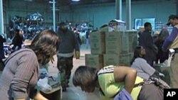 Volunteers sorting items donated for Haiti at a Washington warehouse