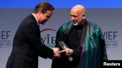 Britaniya Bosh vaziri Deyvid Kameron, Afg'oniston rahbari Hamid Karzay, London, 29-oktabr, 2013-yil.