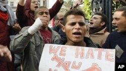 Anti-government demonstrators shout slogans against President Hosni Mubarak in Cairo, Egypt, January 27, 2011.