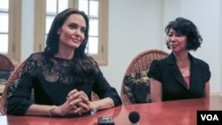 "Actress and filmmaker Angelina Jolie (left) and Cambodian-American Loung Ung, author of ""First They Killed My Father,"" give an exclusive interview to VOA Khmer following a press conference about the premiere of the upcoming Netflix film in Siem Reap province, Cambodia on February 18, 2017. The film ""First They Killed My Father,"" based on Luong Ung's account of surviving the Khmer Rouge regime as a child, premiered Saturday night at an outdoor screening in Angkor Archeological Park. (Neou Vannarin/VOA Khmer)"