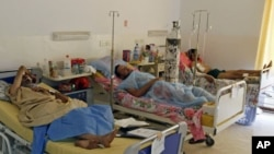 Rebel fighters, who were injured during fighting at Bab al-Aziziya, rest at Maitika Hospital, in Tripoli, Libya, August 27, 2011