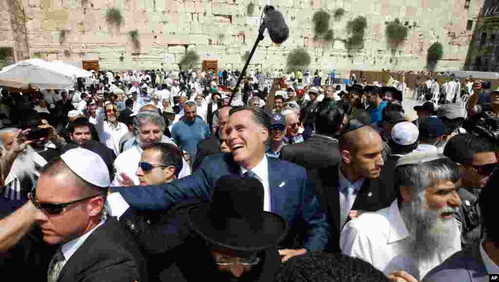 Romney greets the crowd after his visit to the Western Wall.