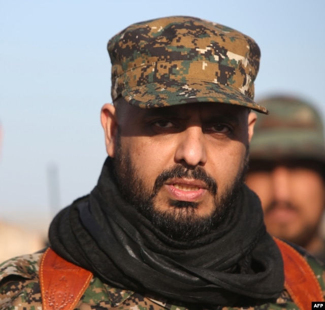 Qais al-Khazali, leader of the Shiite militia Asaib Ahl al-Haq (The League of the Righteous), looks on as he stands in the area of Albu Ajil, east of the northern city of Tikrit on March 7, 2015, during a military operation to retake the Tikrit area. Iraq