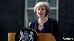 "FILE - British Prime Minister Theresa May, shown speaking to reporters in London, July 13, 2016, says suspending parts of the convention during conflict would allow British troops to take ""difficult decisions"" on the battlefield without fear of having dubious legal claims filed against them later."