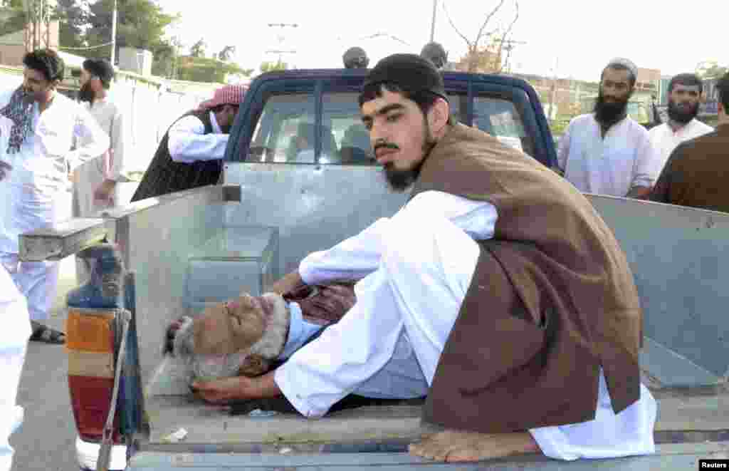 An injured man is transported to the hospital in Quetta, Pakistan, August 9, 2013.