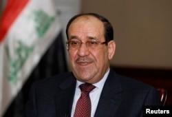 Nuri al-Maliki speaks during an interview with Reuters in Baghdad, Jan. 12, 2014.