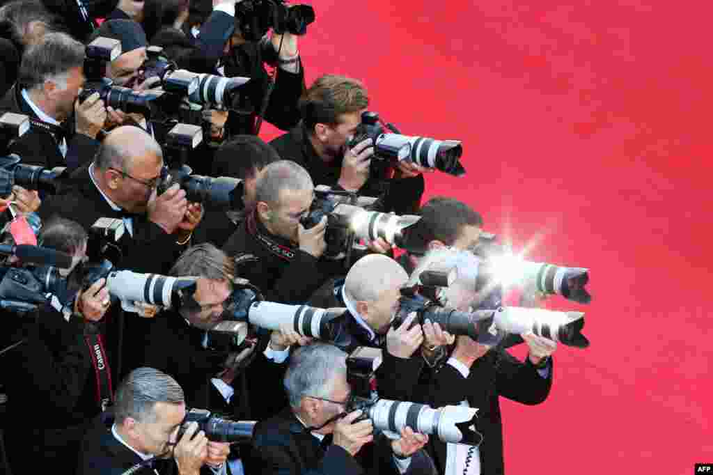 Photographers shoot pictures as guests arrive for the screening of the film 'Mr. Turner' at the 67th edition of the Cannes Film Festival in Cannes, southern France, May 15, 2014.
