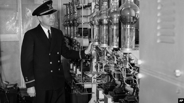 FILE - Coast Guard Ensign Henry H. Lodge, seen March 2, 1952, looks over big glass tubes of a high voltage rectifier unit aboard the Coast Guard Cutter Courier.