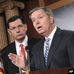 Sen. Lindsey Graham, R-S.C., right, and Sen. John Barrasso, R-Wyo. take part in a news conference, on Capitol Hill in Washington, to repeat their opposition to the national health care law, February 02, 2011.