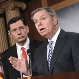 Sen. Lindsey Graham, R-S.C., right, and Sen. John Barrasso, R-Wyo. take part in a news conference,on Capitol Hill in Washington, February 02, 2011.