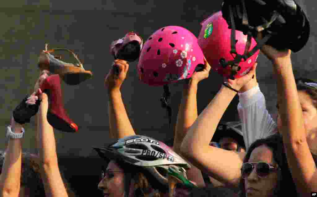 The high-heeled dress wearing cyclists commemorated International Women's Day after reaching the end of their bike route in Mexico City, March 7, 2015.