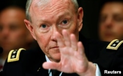 U.S. Chairman of the Joint Chiefs of Staff Gen. Martin Dempsey testifies at a Senate hearing on Capitol Hill in Washington Jun. 11, 2013.