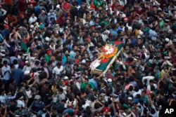 FILE - Bangladeshi mourners carry the coffin containing the body of blogger Ahmed Rajib Haider for funeral in Dhaka, Bangladesh, Feb. 16, 2013.