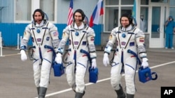 In this handout photo released by Roscosmos Space Agency Press Service U.S. astronaut Chris Cassidy, left, Russian cosmonauts Anatoly Ivanishin, centre, and Ivan Vagner, members of the main crew of the expedition to the International Space Station (ISS), walk prior the launch of Soyuz MS-16 space ship at the Russian leased Baikonur cosmodrome, Kazakhstan, Thursday, April 9, 2020. (Roscosmos Space Agency Press Service via AP)