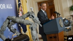 President Barack Obama speaks about manufacturing innovation institutes, Feb. 25, 2014, in the East Room of the White House in Washington.