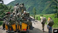 FILE - M23 rebels withdraw from the Masisi and Sake areas in eastern Congo, Nov 30, 2012.