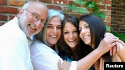 U.S. aid contractor Alan Gross and his wife Judy (2nd L) pose with their daughters during a Friday Shabbat dinner at a friend's home in the Washington area, in this undated family photograph released on October 23, 2010.
