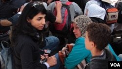 VOA correspondent Ayesha Tanzeem speaks to refugees in Hungary