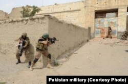 FILE - In undated photos, Pakistani troops have raided and searched suspected militant places in North Waziristan during Zarb-e-Azb counter-militancy operations.