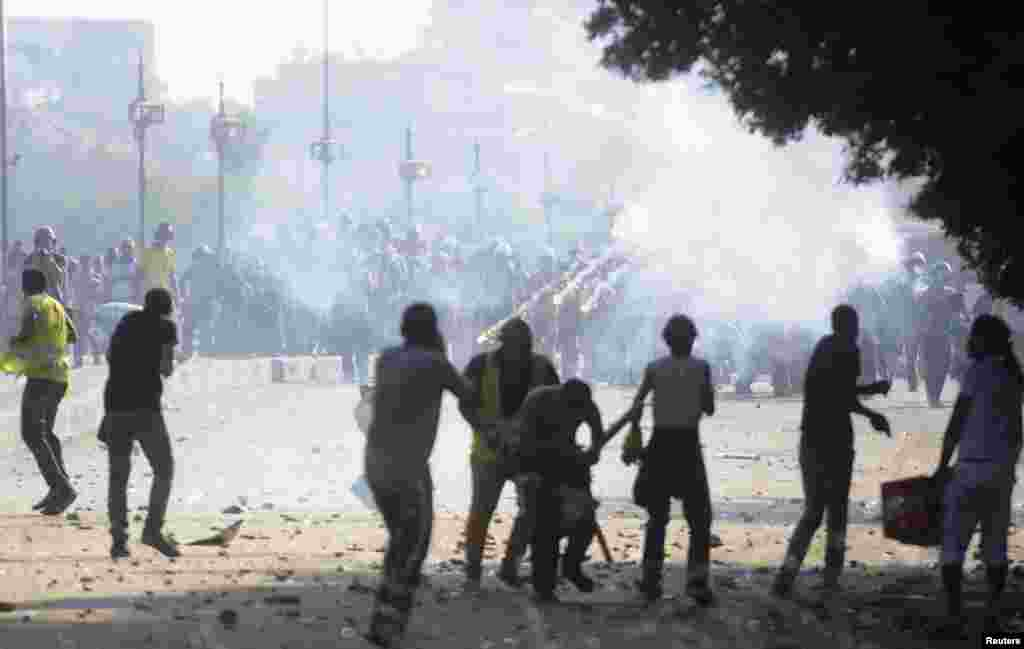 Flares are fired as members of the Muslim Brotherhood and supporters of ousted Egyptian President Mohamed Morsi clash with anti-Morsi protesters, along Qasr Al Nil bridge in Cairo, July 22, 2013.