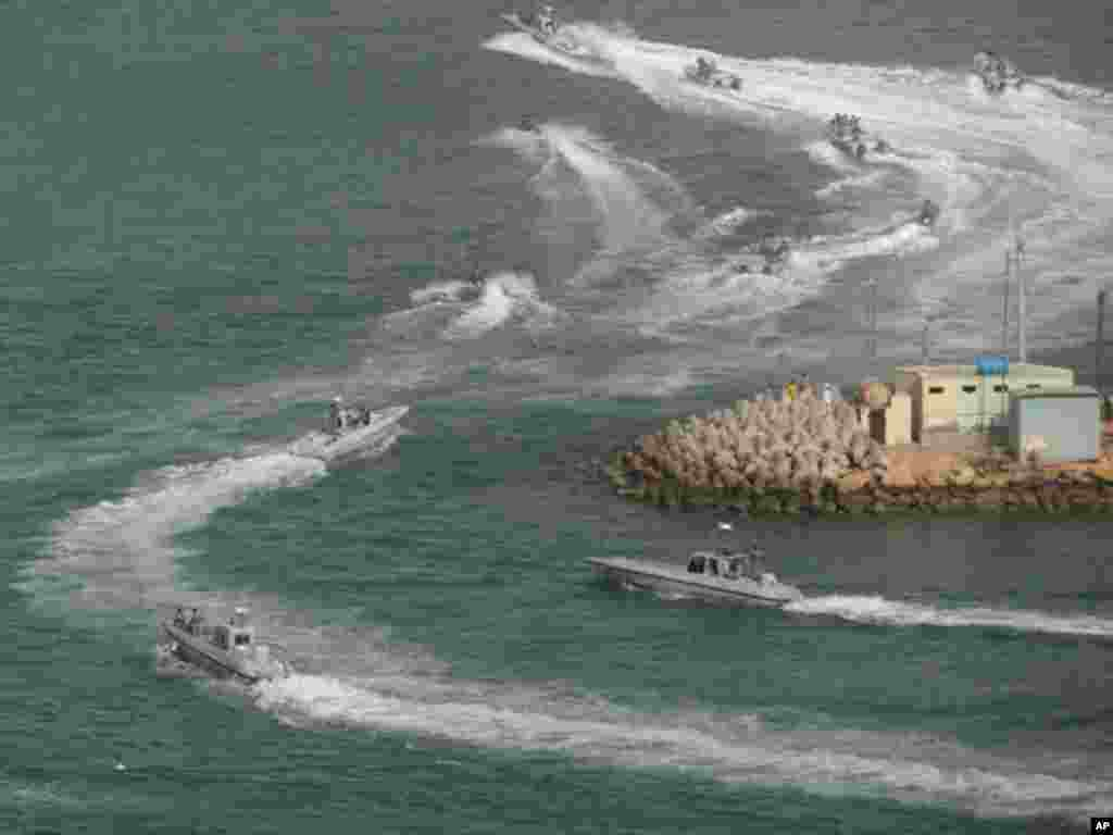 Iranian Navy speed boats attend a drill in the sea of Oman, on December 30, 2011. (AP)