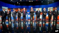 Republican presidential candidates, from left, Chris Christie, Marco Rubio, Ben Carson, Scott Walker, Donald Trump, Jeb Bush, Mike Huckabee, Ted Cruz, Rand Paul and John Kasich take the stage for their debate at Quicken Loans Arena in Cleveland, Aug. 6, 2015. (AP Photo/Andrew Harnik)