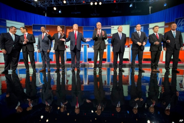 Republican presidential candidates, from left, Chris Christie, Marco Rubio, Ben Carson, Scott Walker, Donald Trump, Jeb Bush, Mike Huckabee, Ted Cruz, Rand Paul and John Kasich take the stage for their debate at Quicken Loans Arena in Cleveland, Aug. 6, 2015.