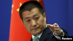 FILE - Chinese Foreign Ministry spokesman Lu Kang at a news conference in Beijing, Oct. 27, 2015.