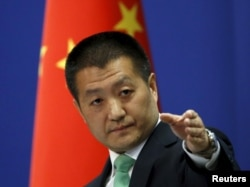 Chinese Foreign Ministry spokesman Lu Kang told reporters at a news conference that Beijing warned a U.S. Navy guided-missile destroyer that cruised close to China's man-made islands in the disputed South China Sea, in Beijing, Oct. 27, 2015.