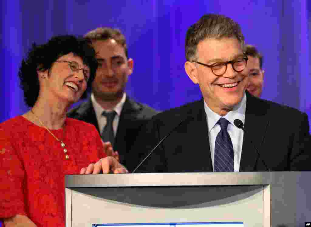 Sen. Al Franken, D-Minn., accompanied by his wife, Franni, left, and other relatives, addresses Democratic party night supporters after winning his Senate race against Republican Mike McFadden, Tuesday, Nov. 4, 2014, in Minneapolis.