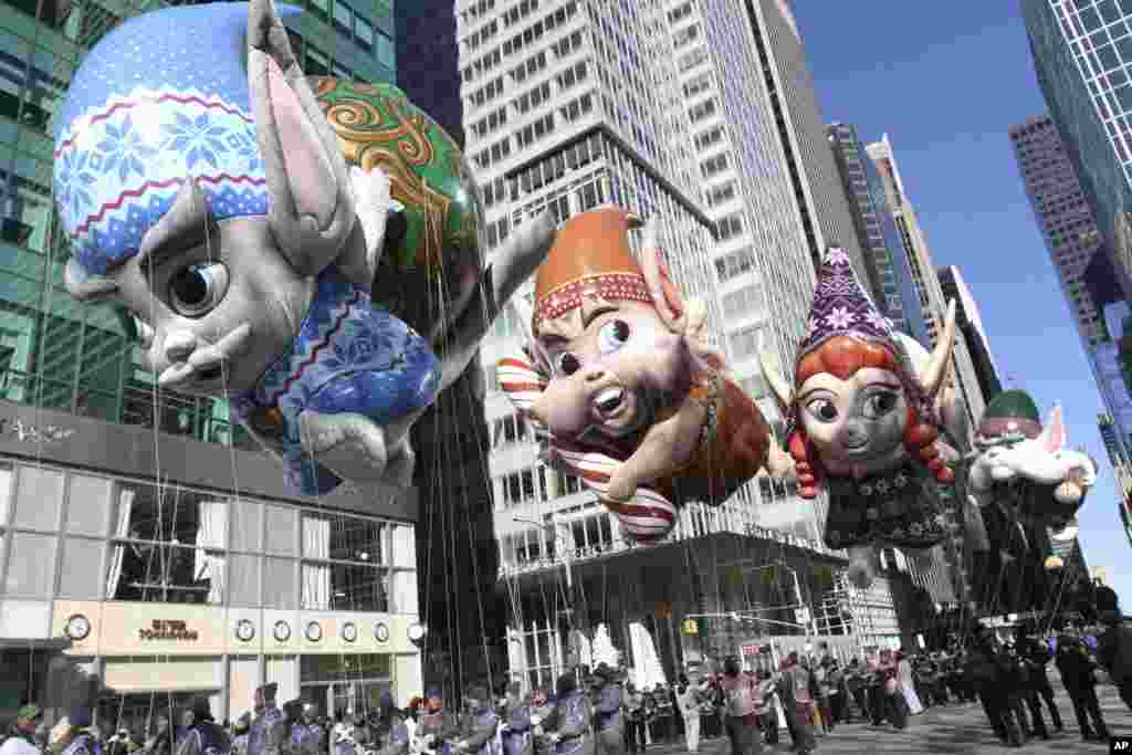 The Fleck, Bjorn, Jojo, and Hugg balloons make their way down New York's Sixth Avenue during the 92nd annual Macy's Thanksgiving Day Parade, in New York.