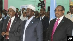 Somali President Sharif Sheik Ahmed, centre, Somali Prime Minister, Abdiwali Mohamed Ali, right, and Somali Parliament Speaker Sharif Hassan Sheik Adan, left, stand together during opening ceremony during the beginning of a nine-day meeting, July 25, 2012
