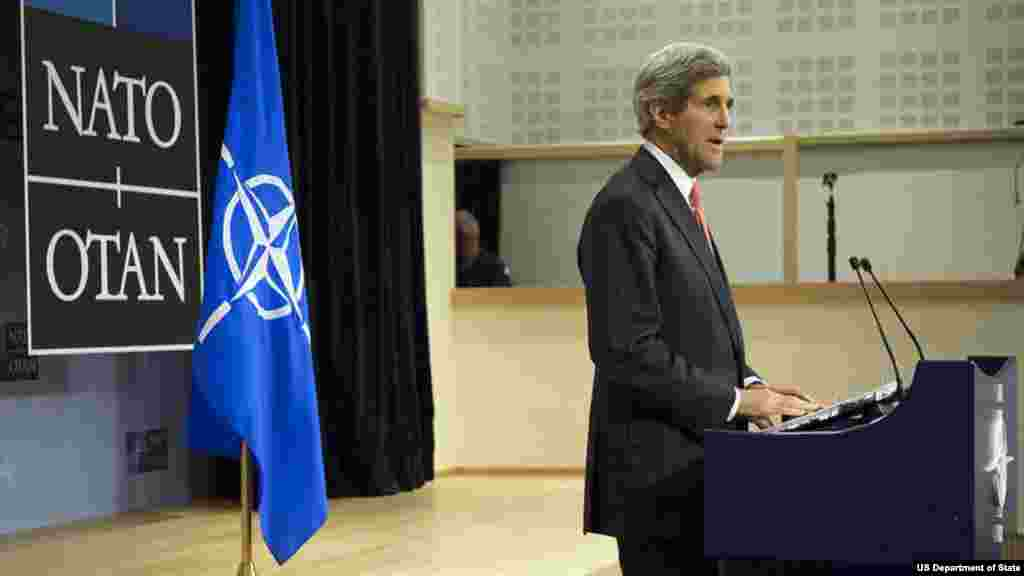 U.S. Secretary of State John Kerry addresses the international press corps during a news conference that followed a NATO Ministerial meeting in Brussels, Belgium, on December 3, 2013.