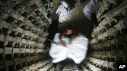 A Palestinian smuggler moves refrigerators through a tunnel from Egypt to the Gaza Strip under the border in Rafah, southern Gaza Strip, October 28, 2010.