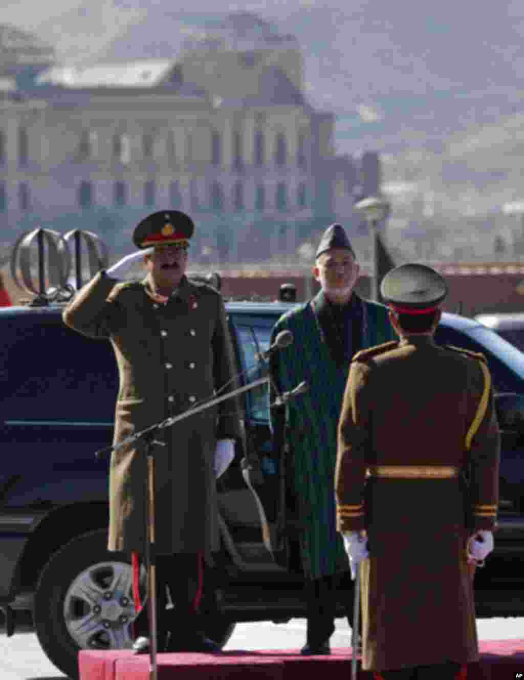 Afghan President Hamid Karzai inspects honor guards before he inaugurated Afghanistan's parliament in Kabul January 26, 2011. Afghan President Hamid Karzai opened parliament on Wednesday, ending a standoff with lawmakers, but setting the stage for a longe