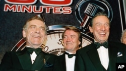 """In this Nov. 10, 1993 file photo, The """"60 Minutes"""" team, from left, Morley Safer, Steve Kroft and Mike Wallace pose at the Metropolitan Museum of Art in New York."""
