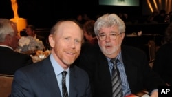 FILE - Directors Ron Howard, left, and George Lucas attend the Academy of Television Arts & Sciences 22nd Annual Hall of Fame Gala in Beverly Hills, California, March 11, 2013.