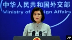 Chinese foreign ministry spokeswoman Jiang Yu responds to questions during a press briefing in Beijing where China reiterated its opposition to the use of force in Libya amid Western air strikes there and called for an immediate ceasefire in the country's