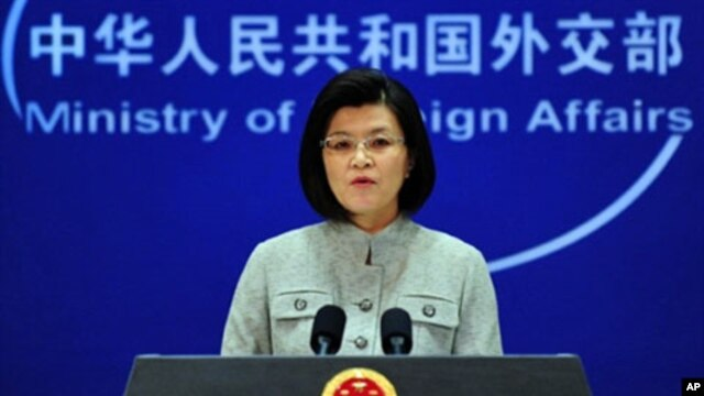 Chinese foreign ministry spokeswoman Jiang Yu responds to questions during a press briefing in Beijing,  March 22, 2011
