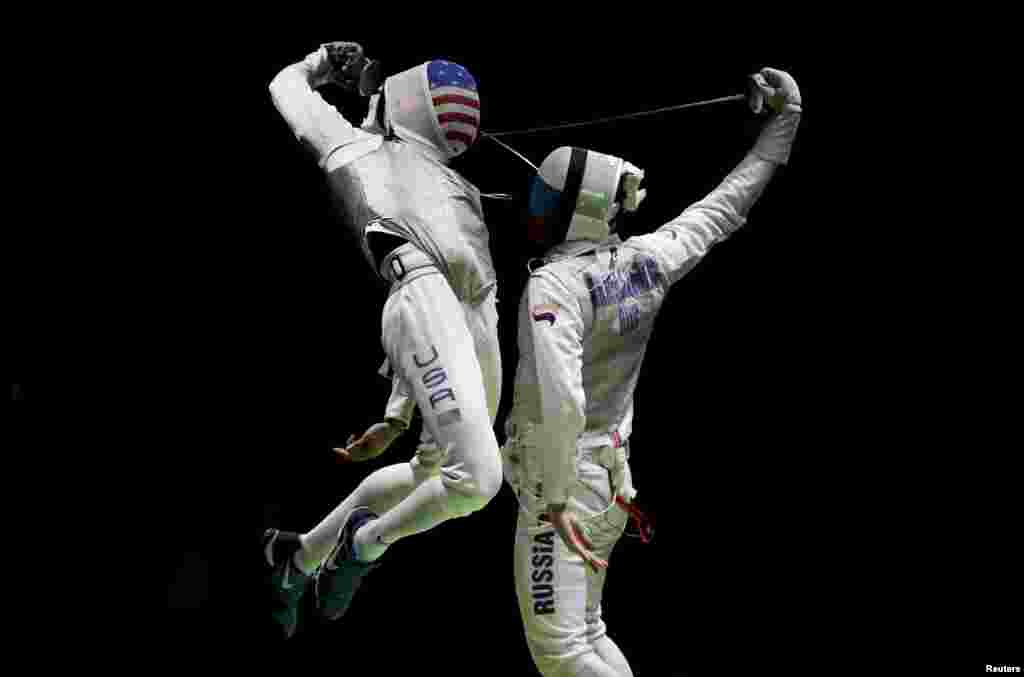 Miles Gerek Meinhardt (USA) of USA competes with Artur Akhmatkhuzin (RUS) of Russia in a foil fencing event at the Olympics in Rio de Janeiro, Brazil