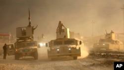 An Iraqi military convoy advances toward the city of Mosul, Iraq, Oct. 19, 2016.