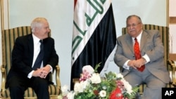 A handout picture from the Iraqi Presidency shows Iraqi President Jalal Talabani (R) meeting with US Defense Secretary Robert Gates in Baghdad, 10 Dec 2009