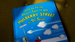 """FILE - A copy of the book """"And to Think That I Saw It on Mulberry Street,"""" by Dr. Seuss, rests in a chair, Monday, March 1, 2021, in Walpole, Mass. (AP Photo/Steven Senne)"""