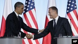President Barack Obama and Poland's Prime Minister Donald Tusk shake hands during a joint news conference at the Chancellery Building in Warsaw, Poland, May 28, 2011