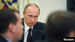 Russian President Vladimir Putin chairs a meeting of the Security Council in Moscow's Kremlin, March 21, 2014.