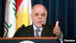 FILE - Iraqi Prime Minister Haider al-Abadi addresses the media during a news conference. Iraq's parliament voted on Nov. 1, 2015, to limit the powers of the country's prime minister in passing reforms, forcing him to seek approval by lawmakers for enacting new measures.