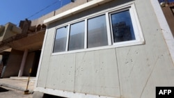 Bullet holes are seen in the guard post in front of the South Korean Embassy following an attack by gunmen on the embassy compound in the Libyan capital, Tripoli, April 12, 2015.