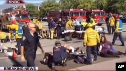 First responders attend to people outside a Southern California social services center in San Bernardino, where one or more gunmen opened fire, shooting multiple people, Dec. 2, 2015.