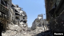 敘利亞另一城市霍姆斯在戰火過後情景